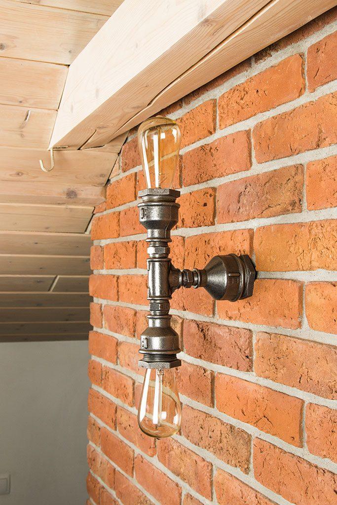 Lampa - kinkiet wykonana z rur żeliwnych na dwie żarówki